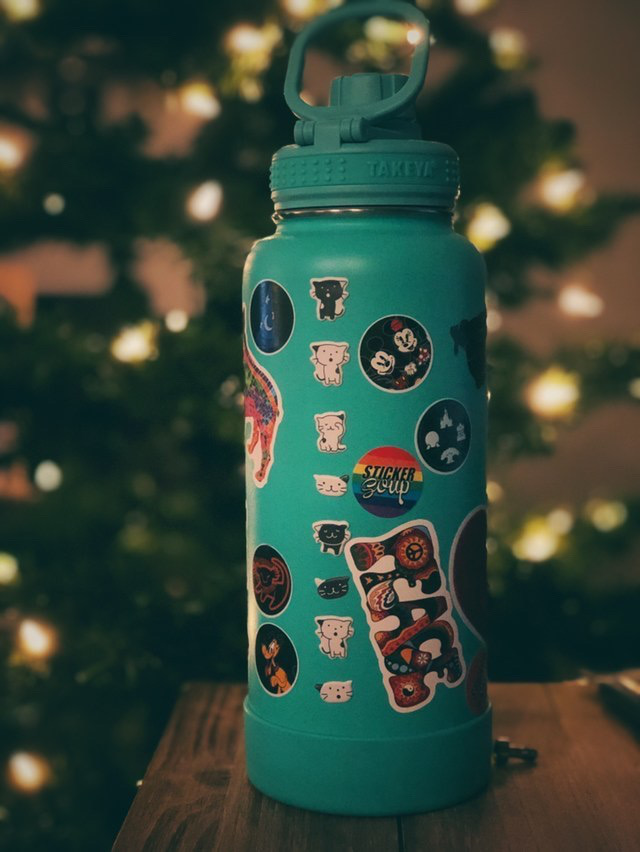 StickerSoup Water bottle in front of a Christmas tree
