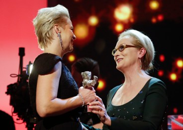 Jury President and actress Meryl Streep (R) hands over the Silver Bear award for the best actress to Trine Dyrholm for her role in the film 'The Commune' during the awards ceremony of the 66th Berlinale International Film Festival in Berlin, Germany February 20, 2016. REUTERS/Fabrizio Bensch