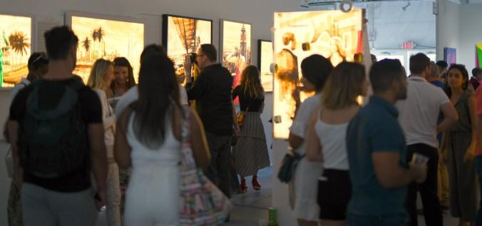 A busy Stick Together Gallery booth at SCOPE art fair Miami Beach