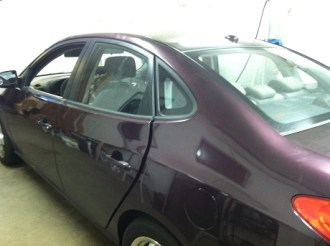 Burgundy Elantra Before Mobile Tinting