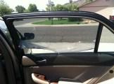 stripping Honda window tint door glass