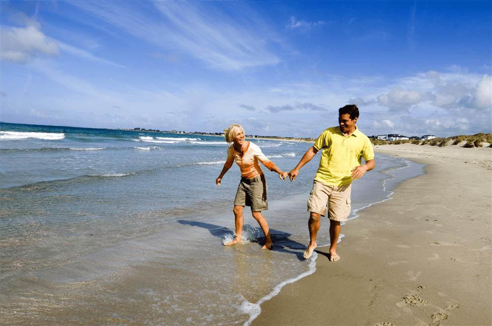 Par vasser på sandstrand Sola på Jæren