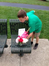 Leaving flowers on a park bench.