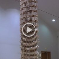 Overthrowing a Giant Domino Tower 2 StoriesHigh is Simply Awesome