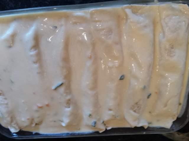 white sauce on enchilada