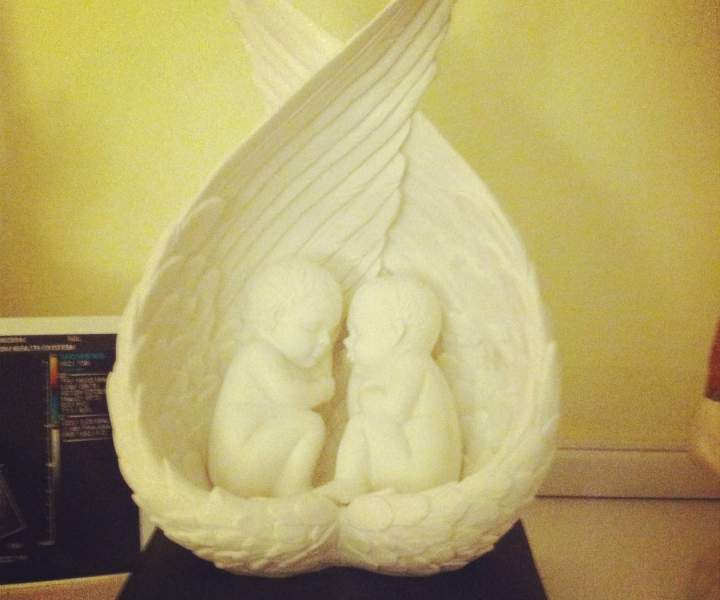 Natalie's sister got them this statue,  which sits on her mantel and contains their ashes underneath.