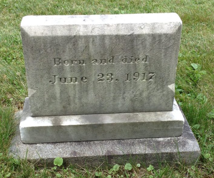 "Headstone reads: ""born and died June 23, 1917"""