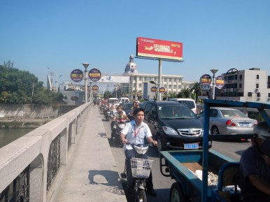 This is a 2 lane bridge. The drivers of mopeds and bike riders are fearless. They create a hazard for themselves as they weave in and out of traffic.