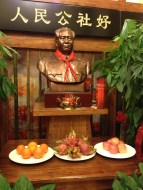 We thought this was strange, they had an offering under the Mao Zedong statue. The food was laid out in honor of Mao Zedong.