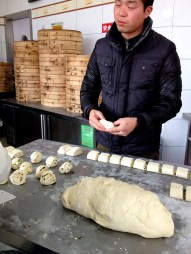 This gentleman invited us in to this part of the kitchen to observe as they folded and prepared the buns for steaming.