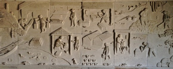 A wall mural depicting roof making in ancient times.