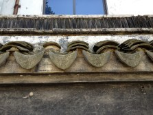 Side molding - part of the roof tiles.
