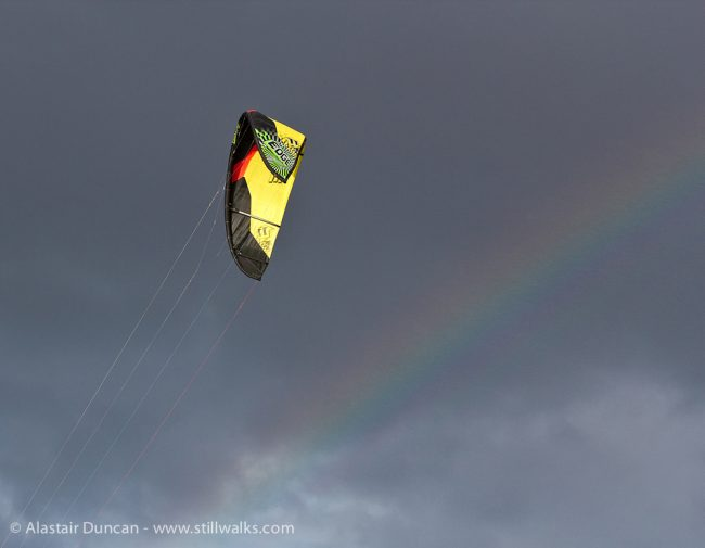 Paraglider and rainbow