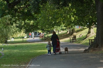 mother and child walking the dog