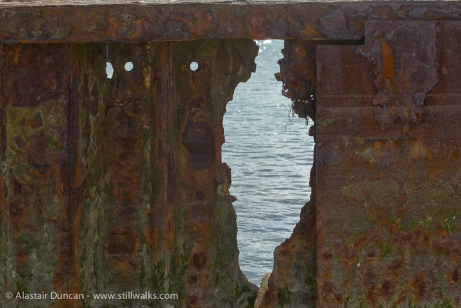 rusty metal hole - Pagham Harbour