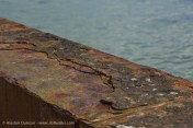 Rusty harbour wall