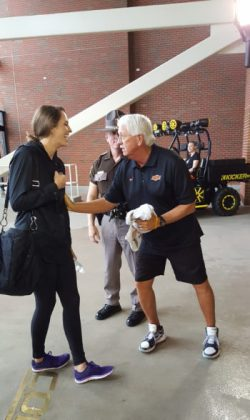 When participants arrive at the West End Zone entrance of Boone Pickens Stadium, they are greeted by the energetic dynamo that is Mac Butler, Director of Football Operations. Here Mac meets KOCO's Markie Martin.