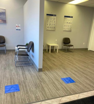 2 accessible social distancing indicators sit 6 feet apart in a medical office