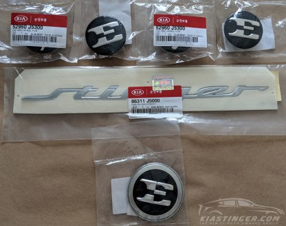"The full OEM ""E"" badge package for your Kia Stinger minus the GT and AWD badges"