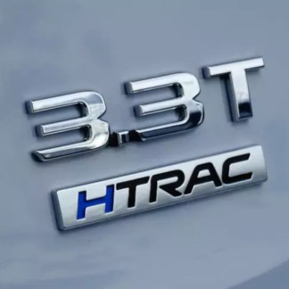 3.3T HTRAC v6 turbo badge on car