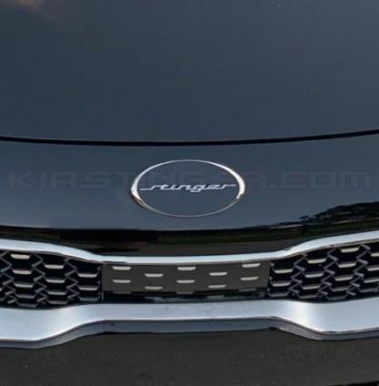 oval stinger emblem on front of kia