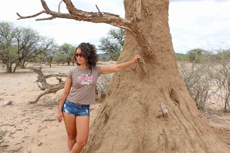 Alya next to a termite nest on the way to Etosha