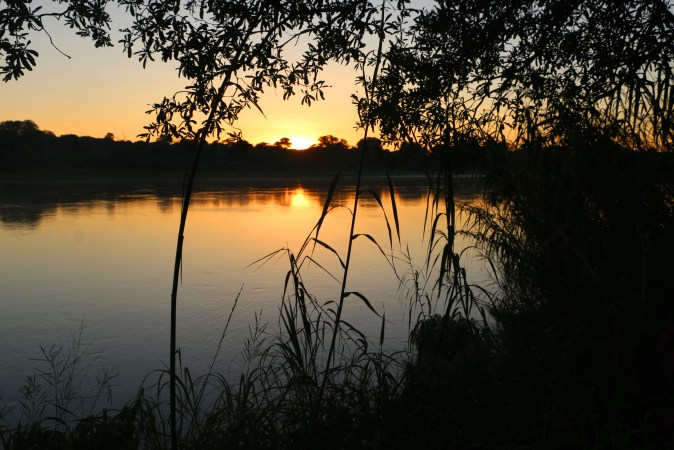 Stunning sunrise at Ngepi campsite. Caprivi road trip