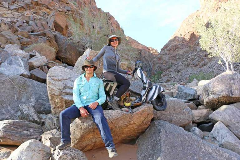 Campbell and Alya with an old scooter on the Fish River Canyon hike