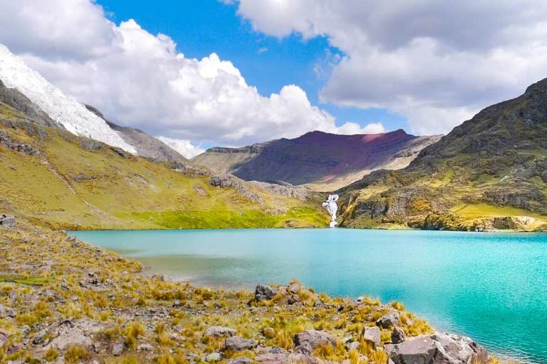Stunning scenery of a lake and its surrounding on one of the best treks in Peru