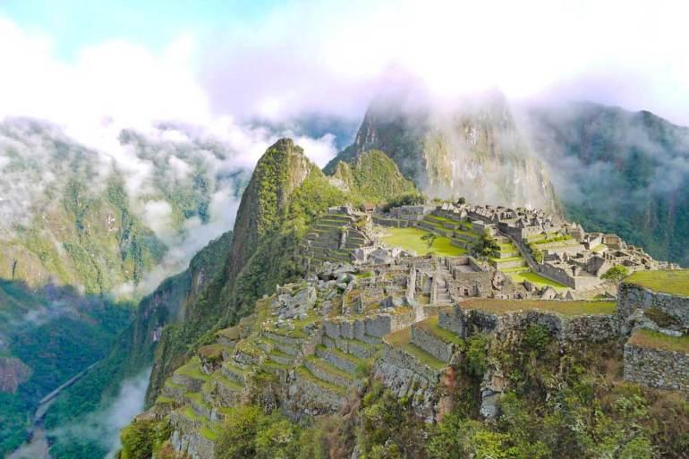 Machu Picchu ruins with Huaynapicchu Mountain on the background
