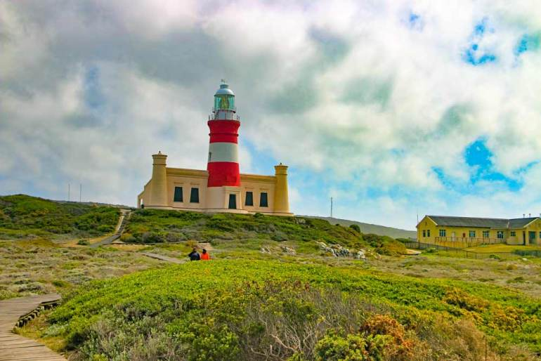 Cape Agulhas lighthouse on the top of the hill