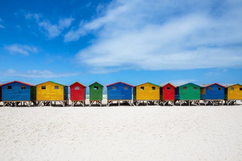 Colorful wooden cabins on the sandy beach in Muizenberg