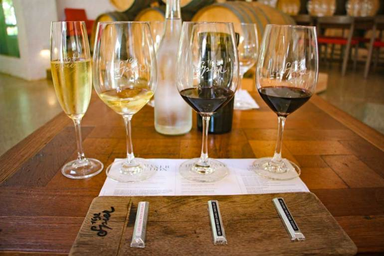 Two red and one white wine, a glass of Champagne and three chocolates at Spier wine farm in Stellenbosch
