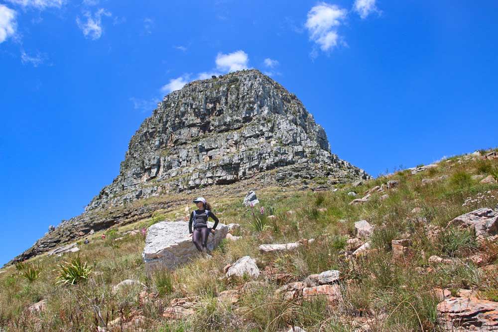 Alya sitting on a boulder with Lion's Head peak behind