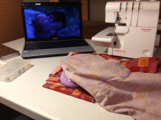 I usually watch Netflix while sewing. :)