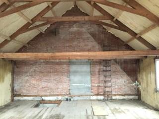 Pakhûs muur oostzijde, met 3 bouwlagen