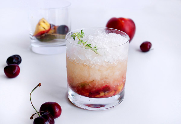 Grilled Summer Fruit Cachaça Smash Cocktail // stirandstrain.com