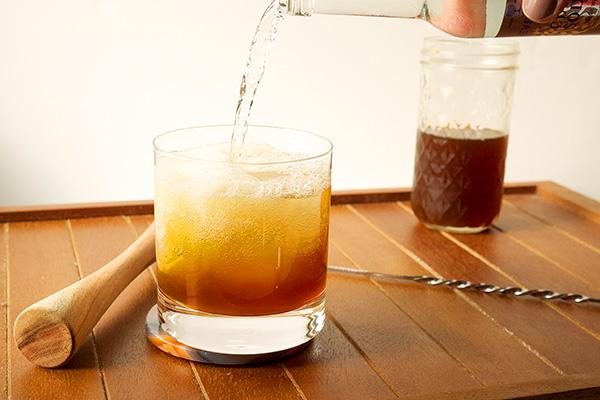 Tangy Cider Fizz Cocktail // stirandstrain.com