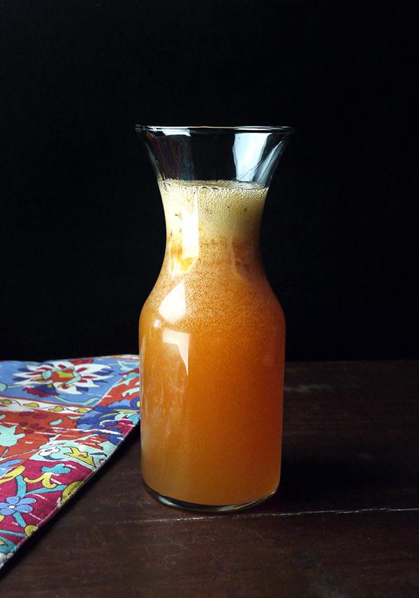Sparkling Caramelized Peach Rum Punch // stirandstrain.com