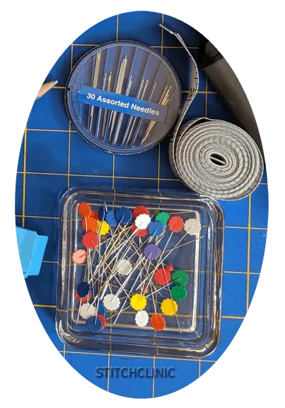 needles, straight pins, fabric measuring tape