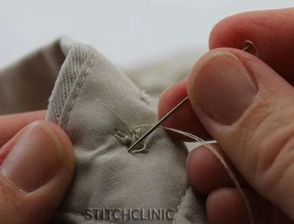 taking a few more stitches to secure the button