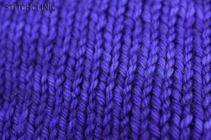 Up close view of bright blue knit fabric