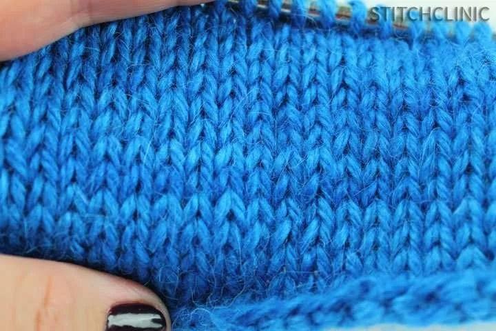 blue yarn knit into the stockinette stitch