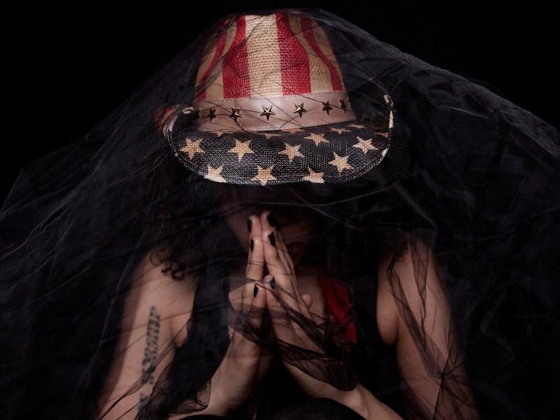 "Imani Coppola premieres remix of her single ""Contributing Member of Society"""