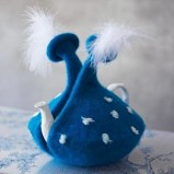 blue tea cosy with feathers
