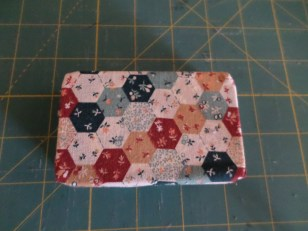 fabric covered tin
