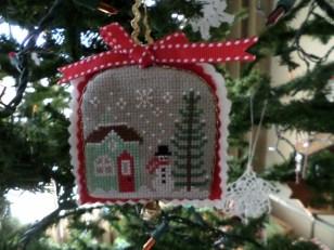 winter scene ornament on tree