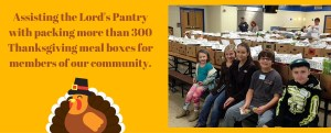 Assisting the Lord's Pantry with packing more than 300 Thanksgiving meal boxes for members of our community.