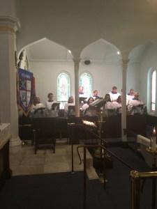 vested choir in loft