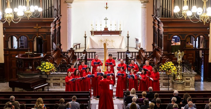 The Choir in red cassocks at St James'